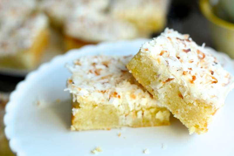 Lime coconut brownies topped with coconut buttercream and perfectly toasted coconut