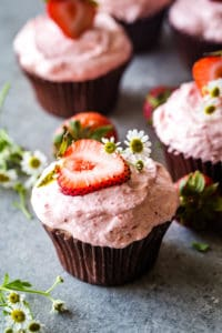 strawberry cupcakes with strawberry on top