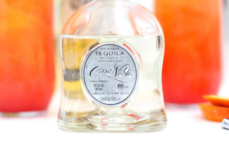casa noble tequila bottle to be used in a corona cocktail