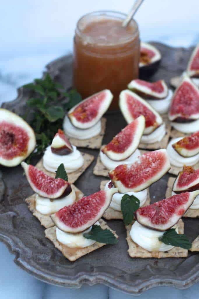 Perfect Summer Appetizer Fig Mascarpone Crackers with drizzled honey