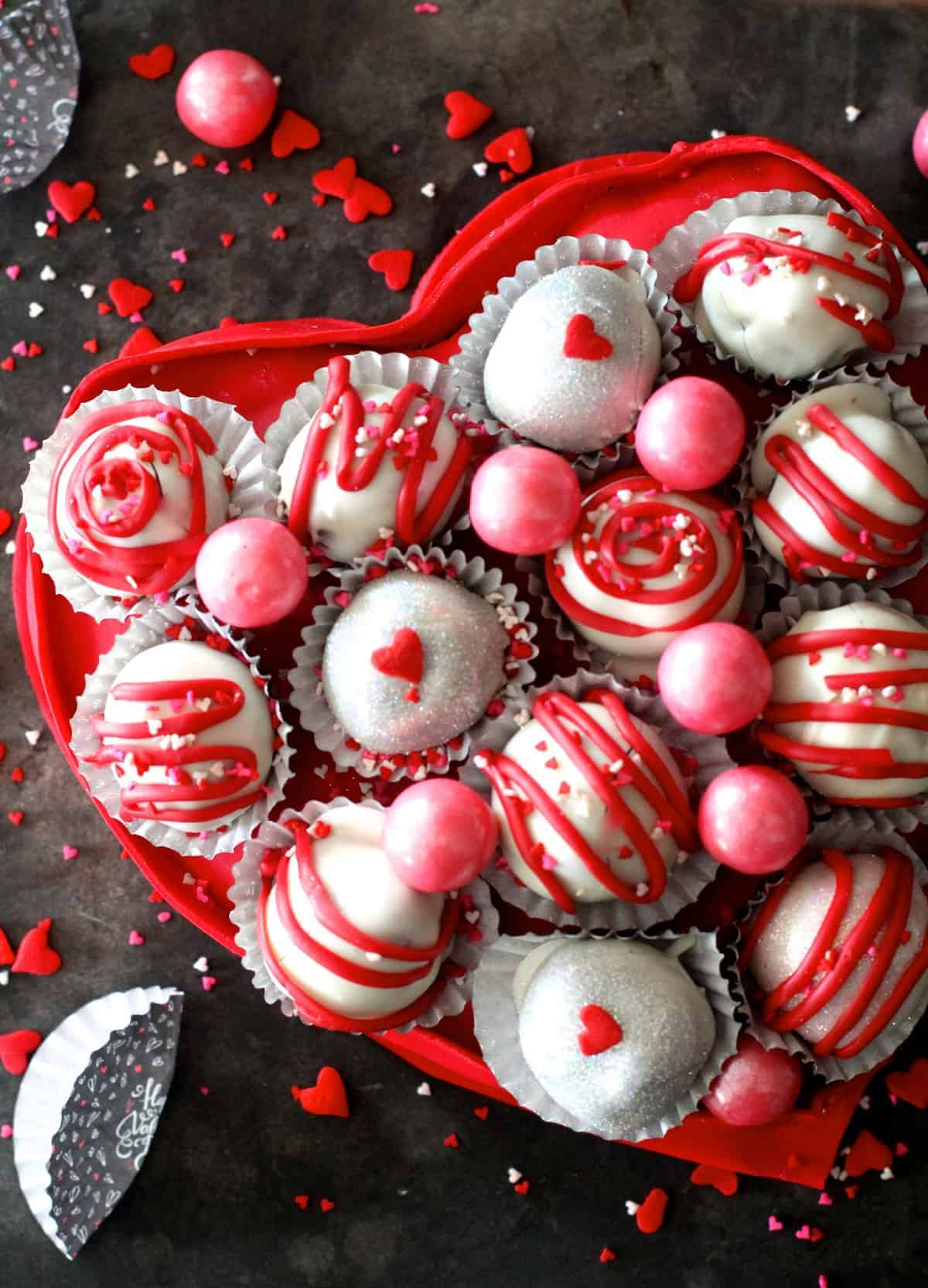 What is Valentine's day without a heart shaped box full of chocolates? Well this year, instead of buying one, make a completely edible heart box and fill it with fun cake balls.