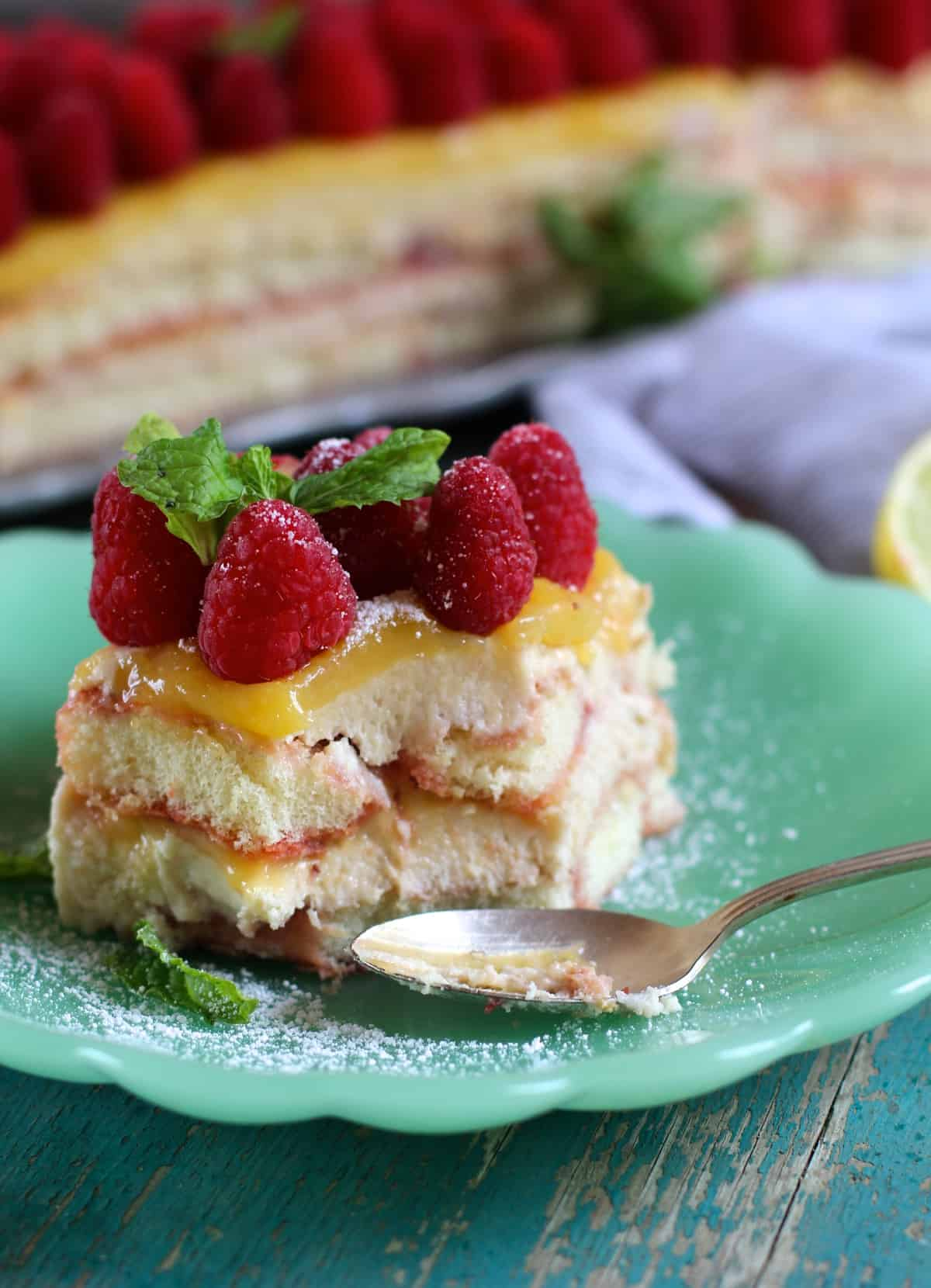 layers of creamy mascarpone, fresh raspberries, tangy meyer lemon curd, and sweet lady fingers