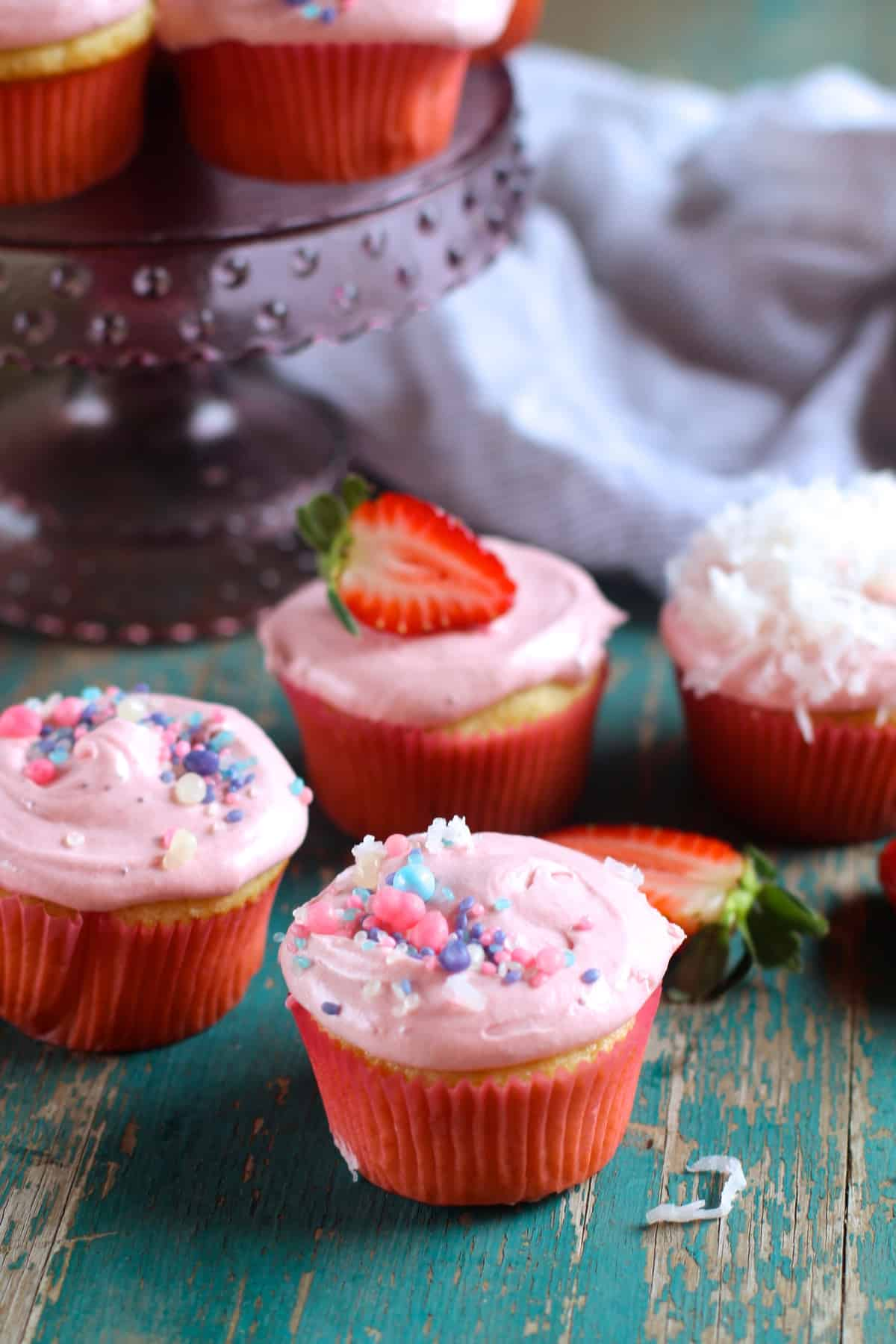 A light and buttery coconut cupcake topped with fresh strawberry frosting