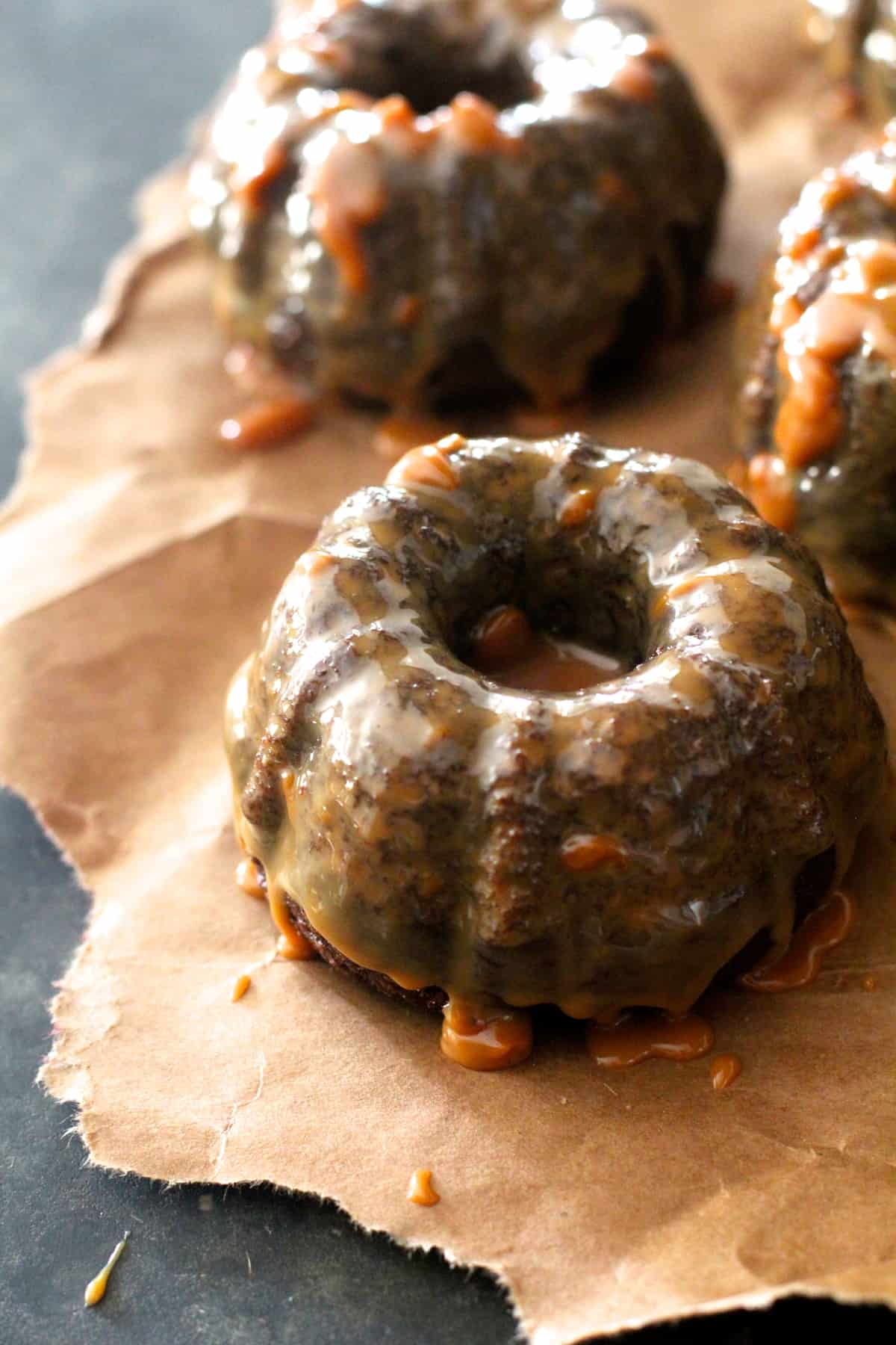 Rich caramel sauce poured over dense, fudgy chocolate pound cakes