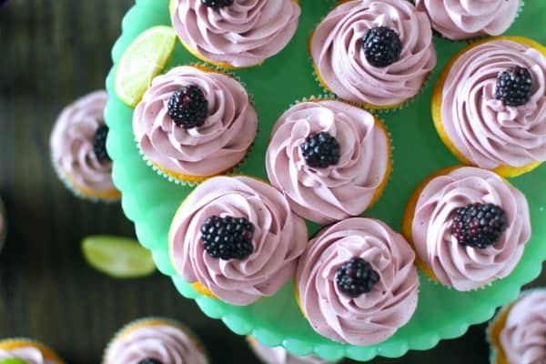 Soft lime cupcakes topped with a sweet blackberry cream cheese frosting
