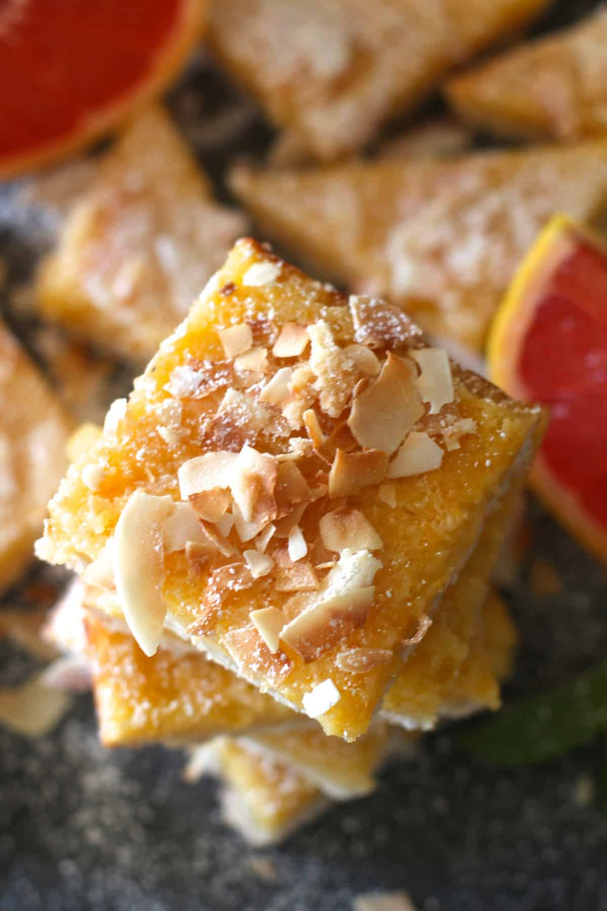 A twist on the traditional lemon bars these bars combine tangy grapefruit with a coconut shortbread crust