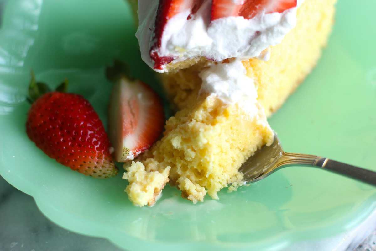 easy Tres Leche Cake slice with fork taking piece out
