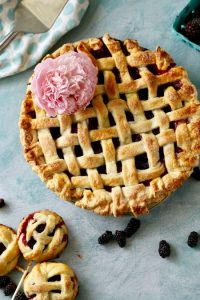 Fresh vine ripe boysenberries in a flaky all butter lattice crust. This boysenberry pie is easy to make and delicious!