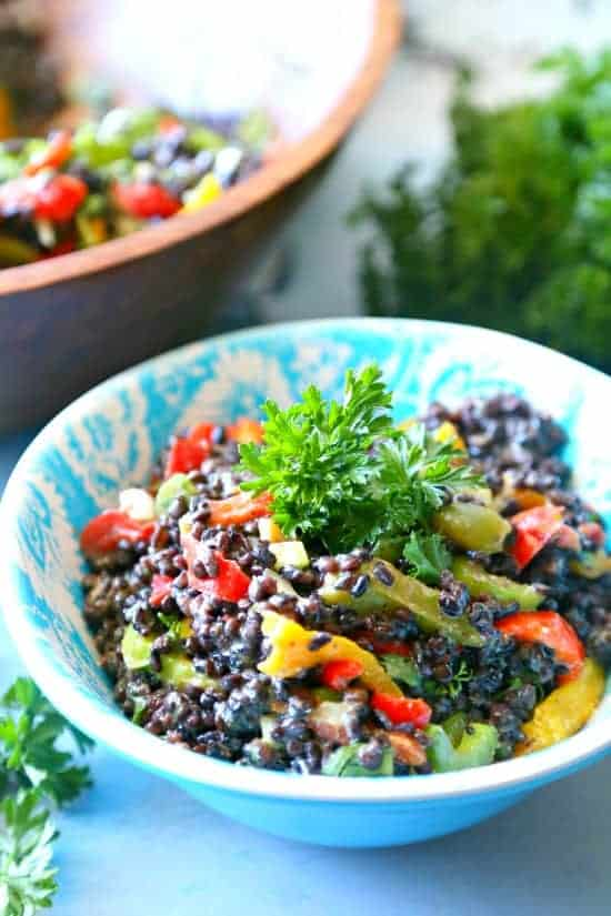 A delicious salad made of lentils, quinoa, and rice combined with fresh crunchy veggies and a delicious mustard dressing.
