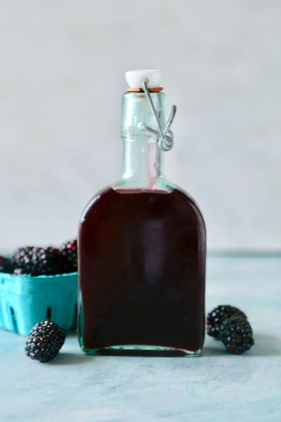 Fresh homemade copycat Ihop blackberry syrup with crispy Belgium Waffles