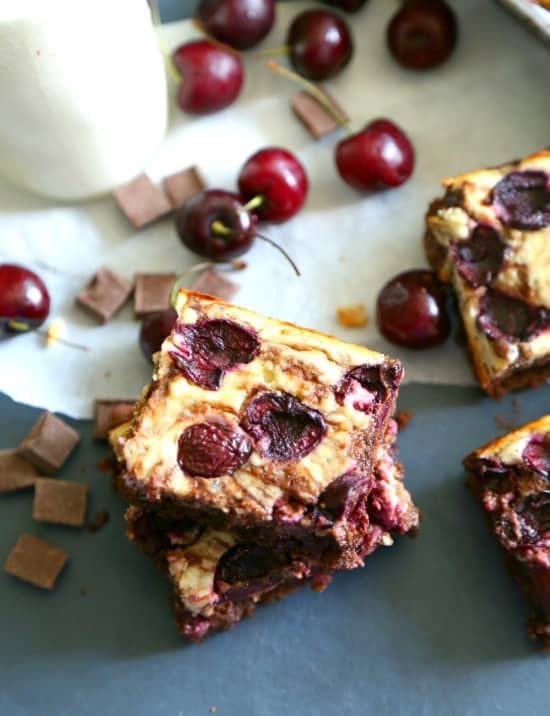 Decadent dark chocolate brownies, swirled with silky cream cheese cheesecake filling, and studded with sweet summer cherries.