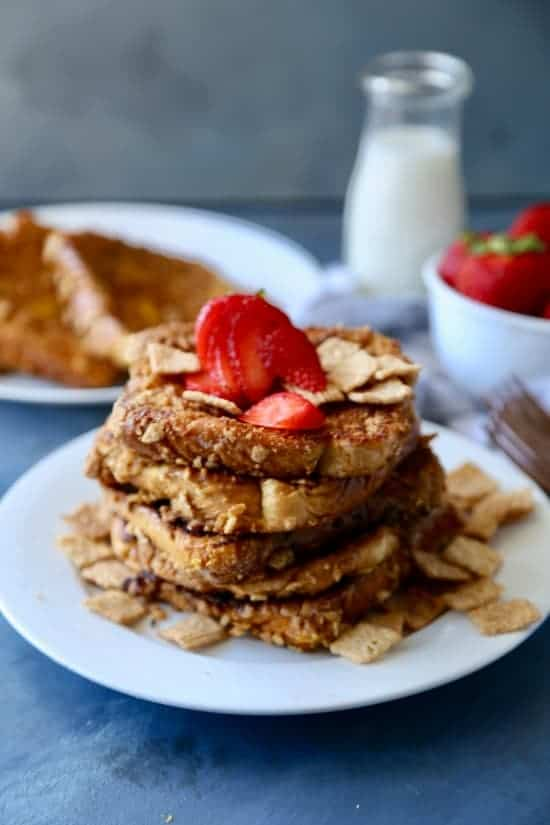 A crushed Cinnamon Toast Crunch  coated french bread that is crispy on the outside and soft in the center. Makes for the perfect fun breakfast or brunch.