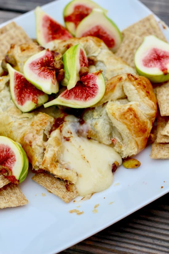 Fresh tiger fig topped baked brie in crispy puff pastry