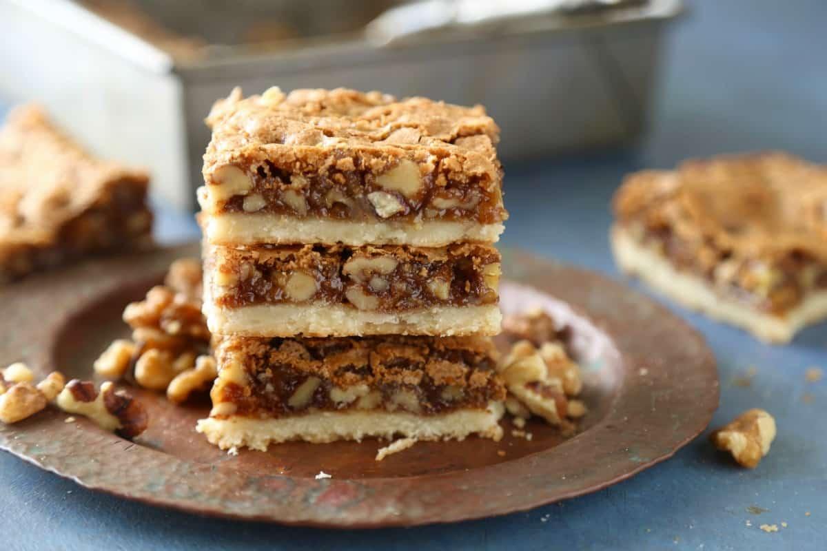 Brown sugar walnut bars have a buttery shortbread base and a sweet brown sugar walnut topping.
