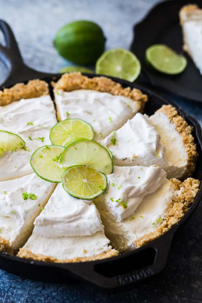 no bake key lime pie sliced with limes on top