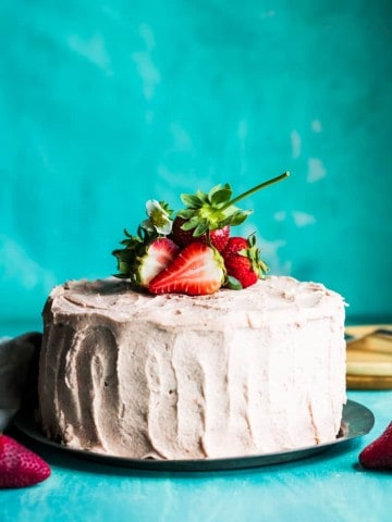 strawberry rhubarb layer cake with strawberries on top