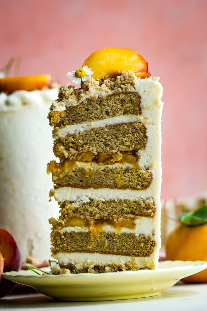 cut slice of peach layer cake