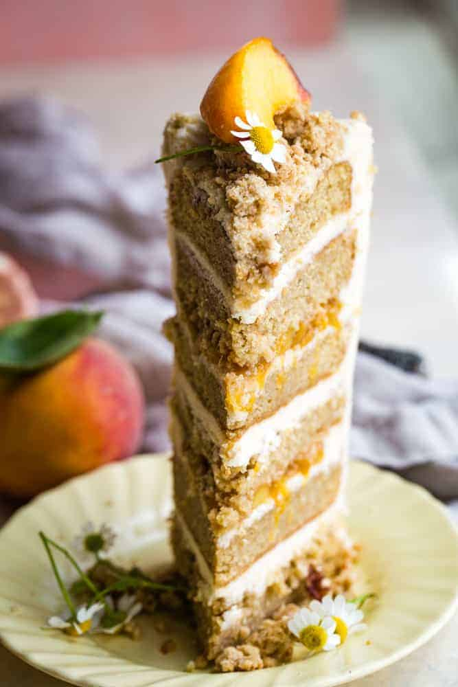 slice of peach layer cake