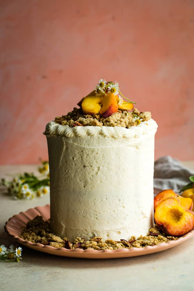 Tall peach layer cake with crumble topping