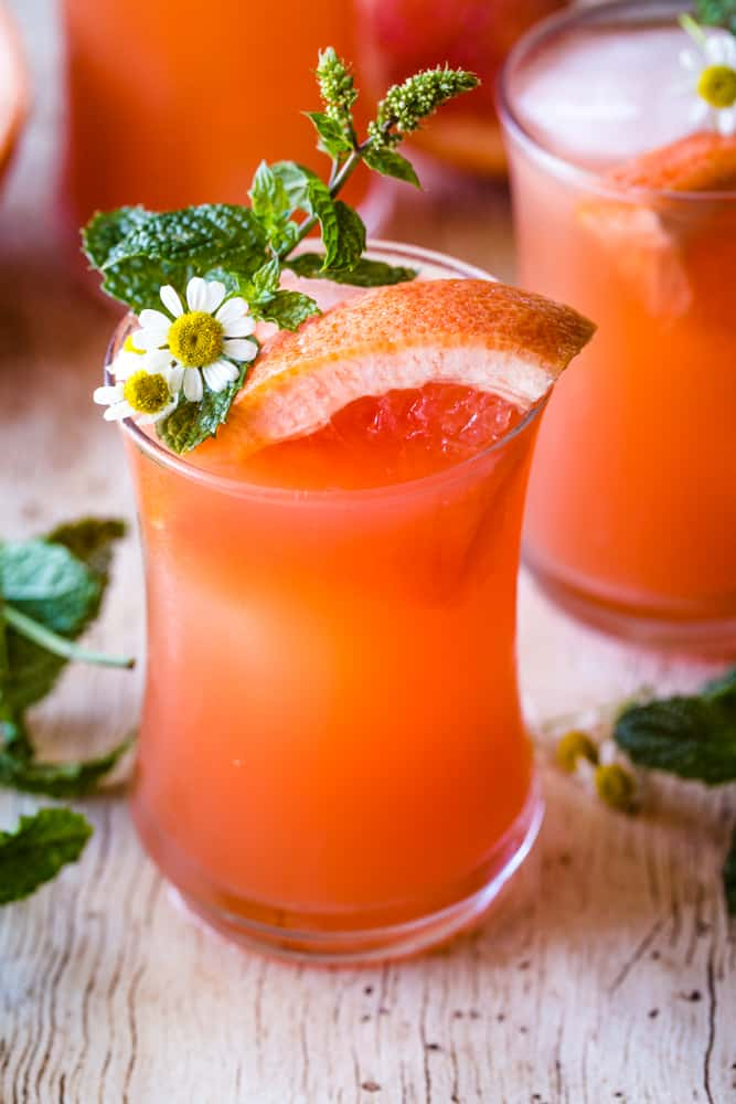 mint grapefruit vodka cocktail in a glass and garnished