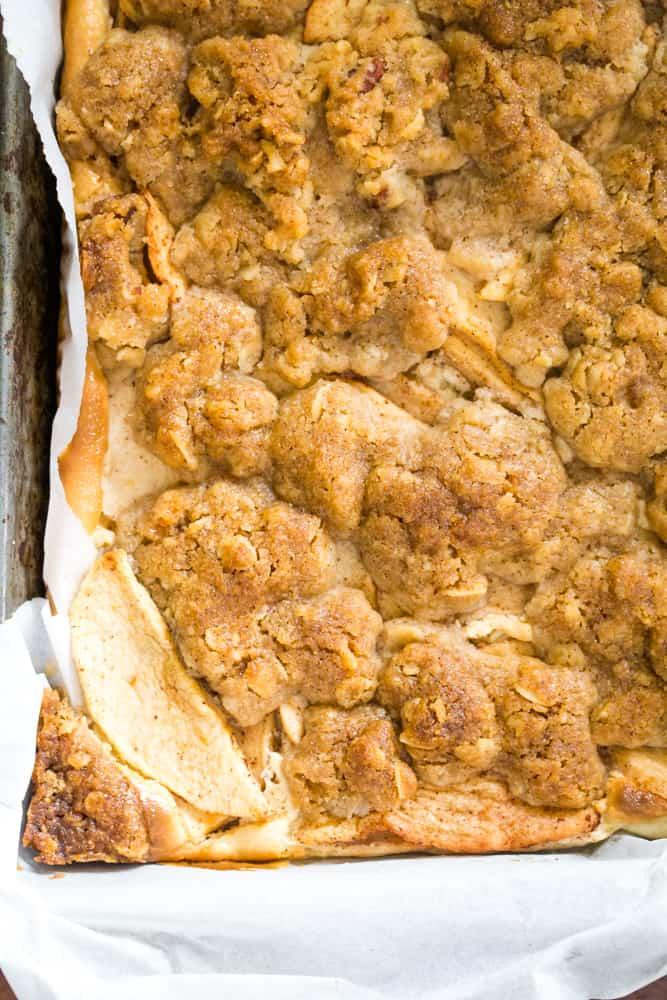 caramel apple cheesecake bars in pan