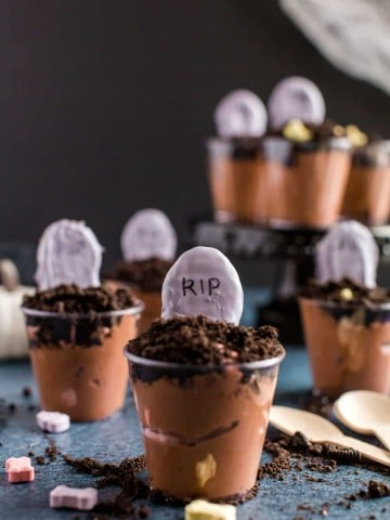 graveyard pudding cups with oreo crumble and white chocolate covered tombstones