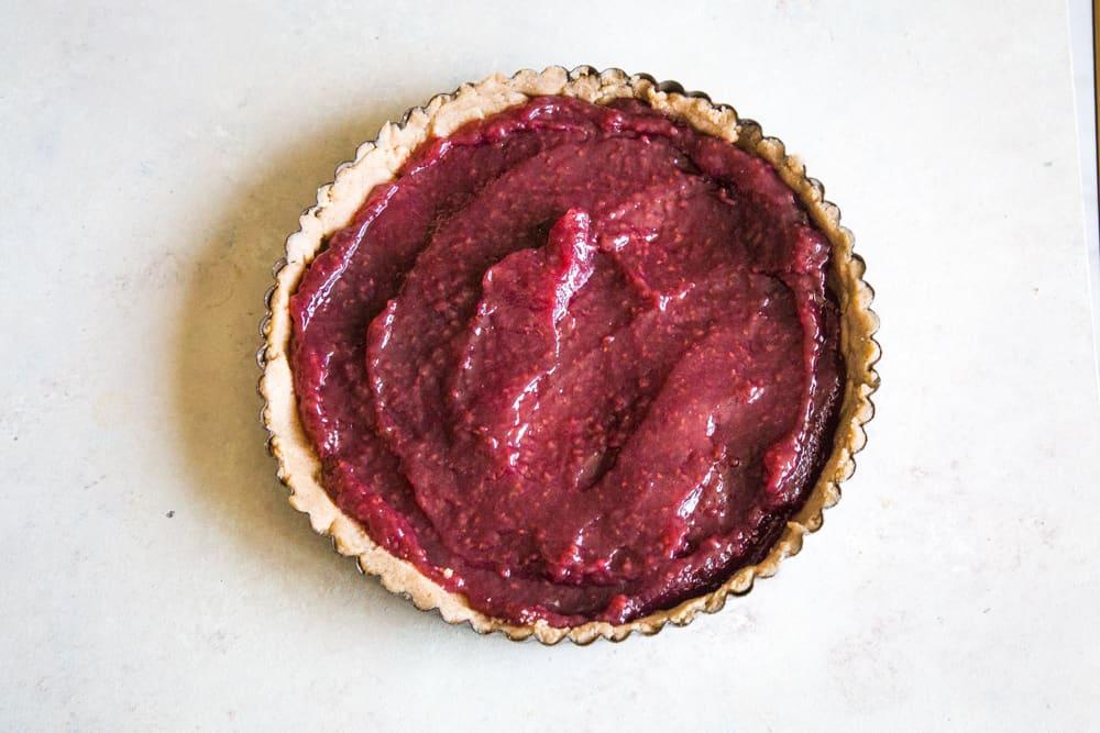 linzer torte recipe raspberry jam filling in tart pan