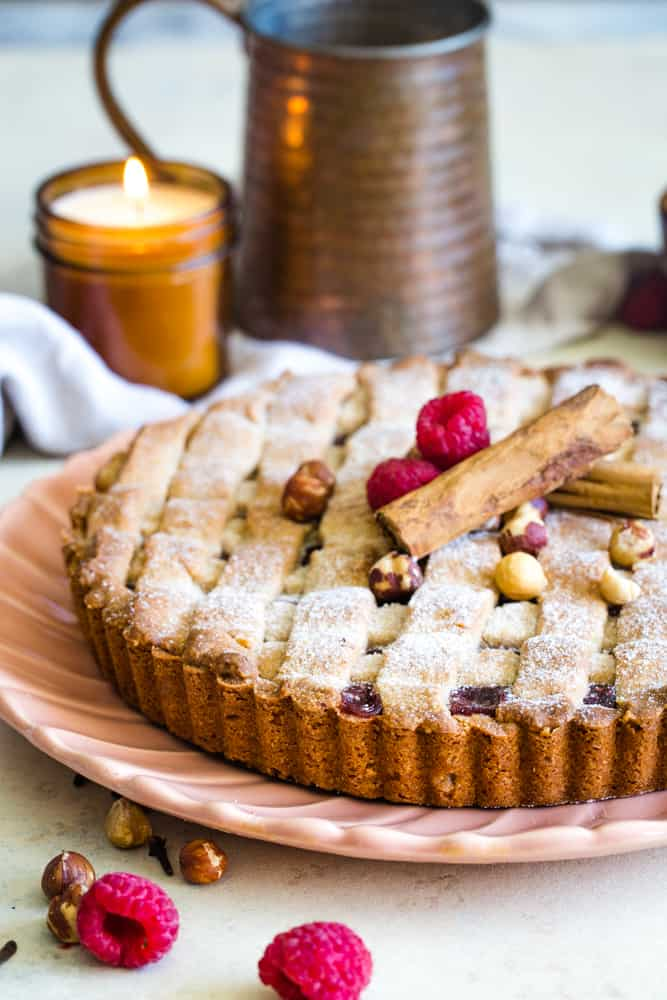 linzer torte on plate with candle in background