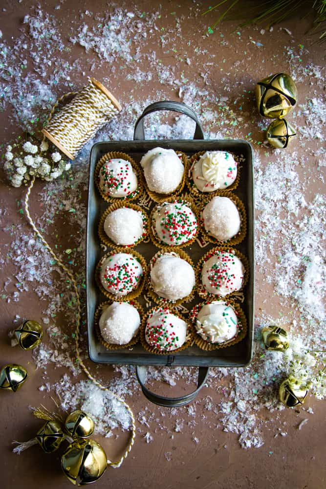 tray of vanilla almond butter truffles with yarn and bells
