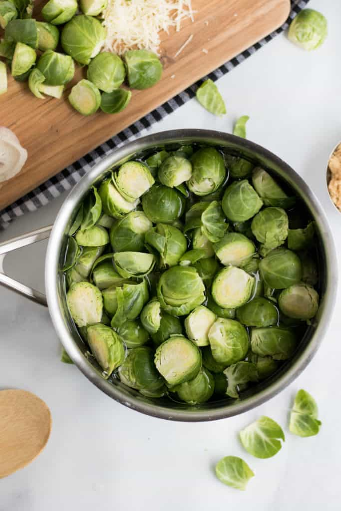 brussels sprouts au gratin in pan ready for a boil