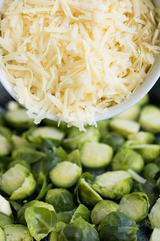 layering the cheese for the brussels sprouts au gratin