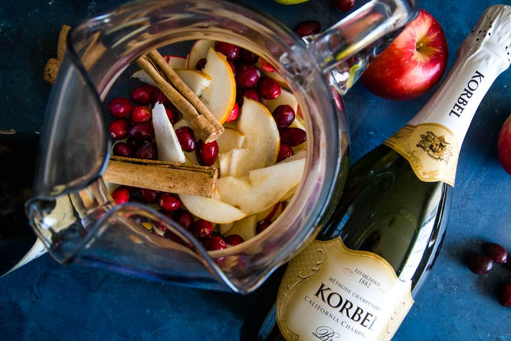 pitcher of fruit and bottle of korbel