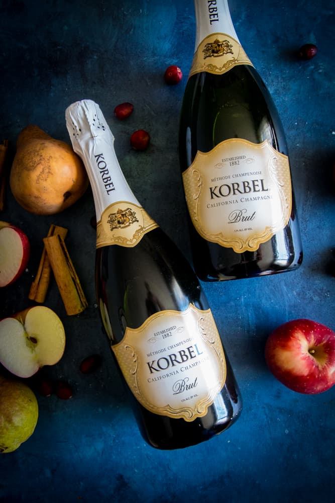 bottles of korbel and apples