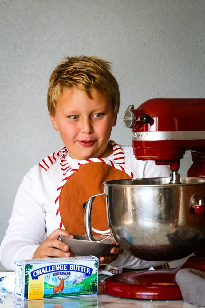 boy with mixer making cranberry spice cake