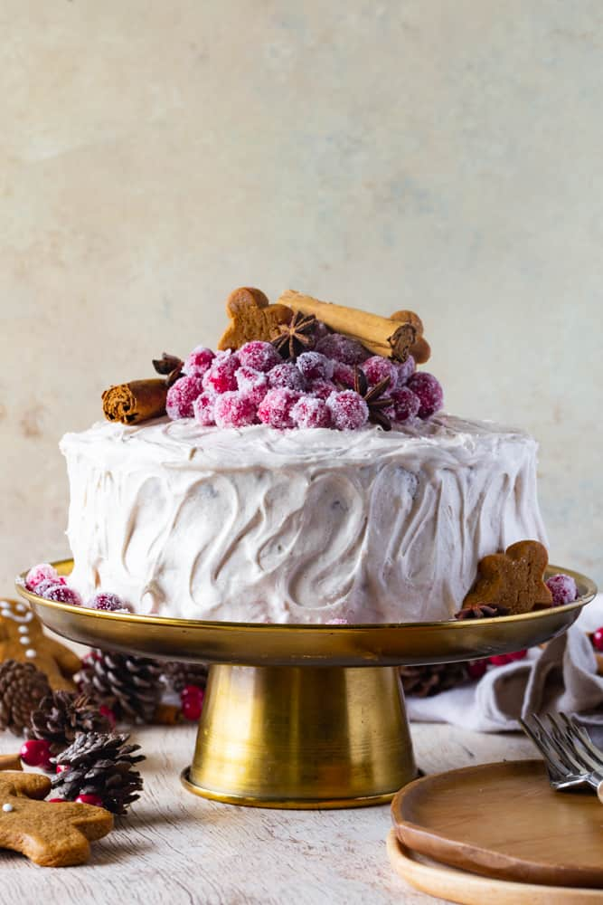 gingerbread layered cake on a gold cake stand