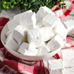 homemade vanilla marshmallows in white bowl with red dish towel