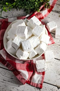 white plate of homemade vanilla marshmallows