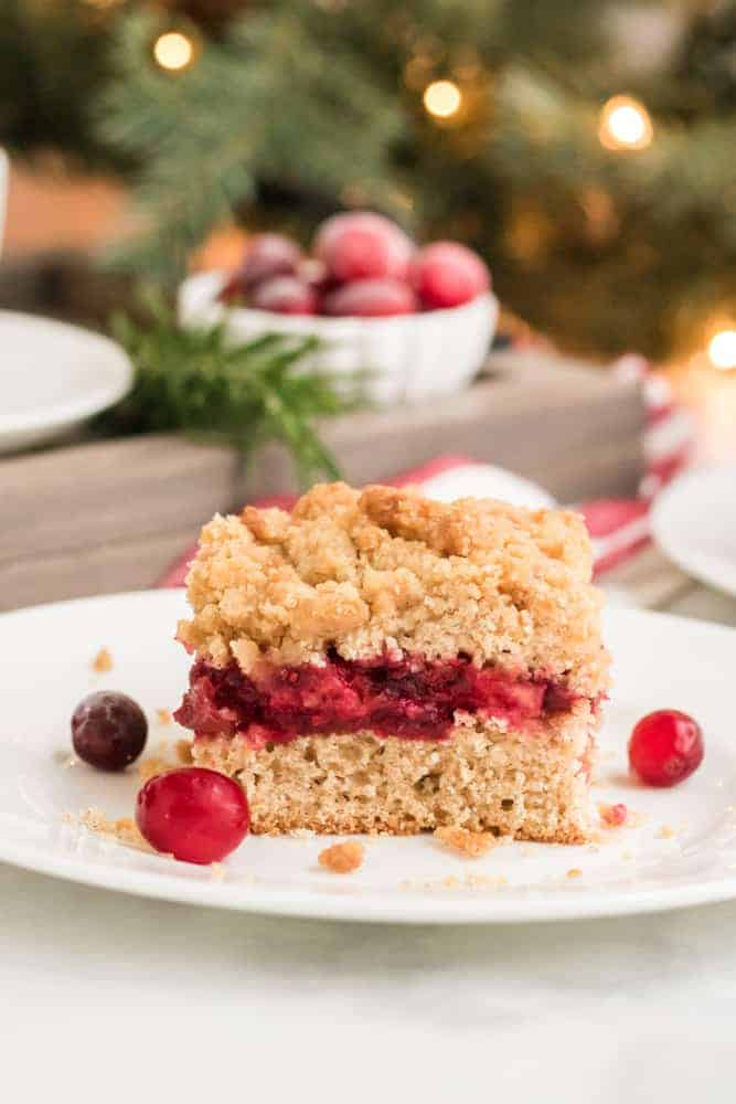slice of cranberry sauce coffee cake on white plate