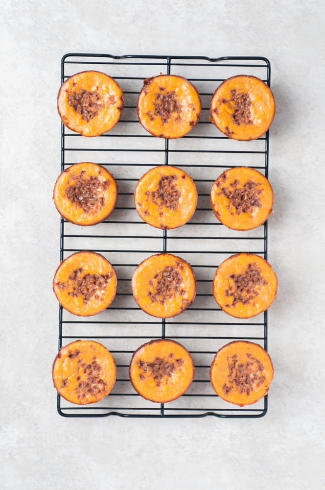 cooling rack with mini pumpkin cheesecakes