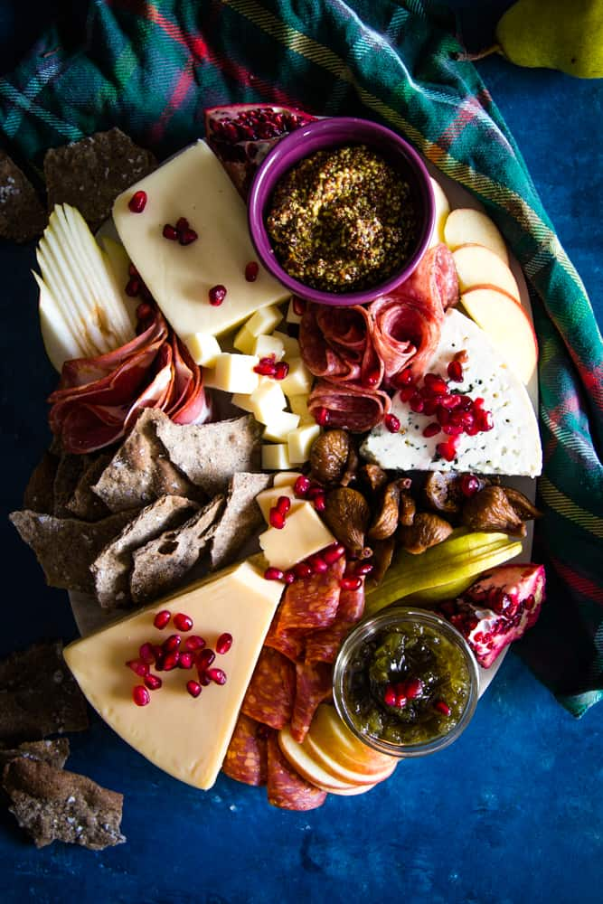 holiday cheeseboard on blue background