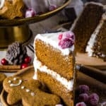 slice of gingerbread layered cake on a wood plate