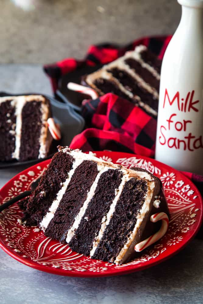 peppermint bark layer cake slices on red plate