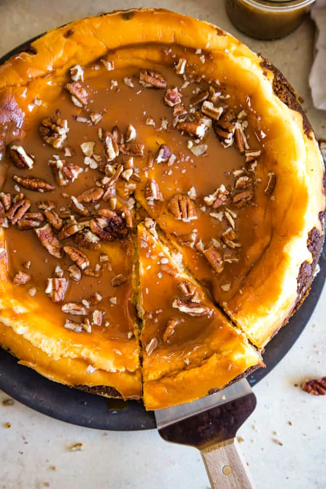 taking a slice of sweet potato swirled cheesecake