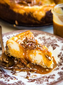 slice of sweet potato swirled cheesecake on brown plate