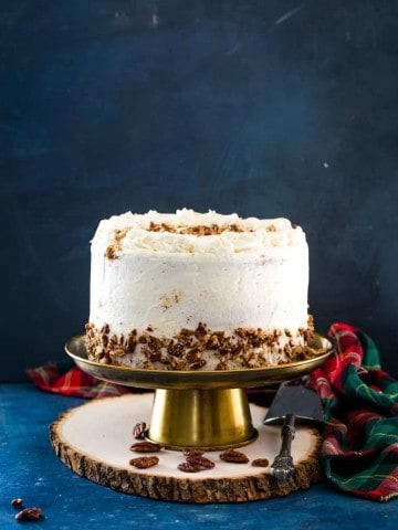 eggnog layer cake on a gold cake stand