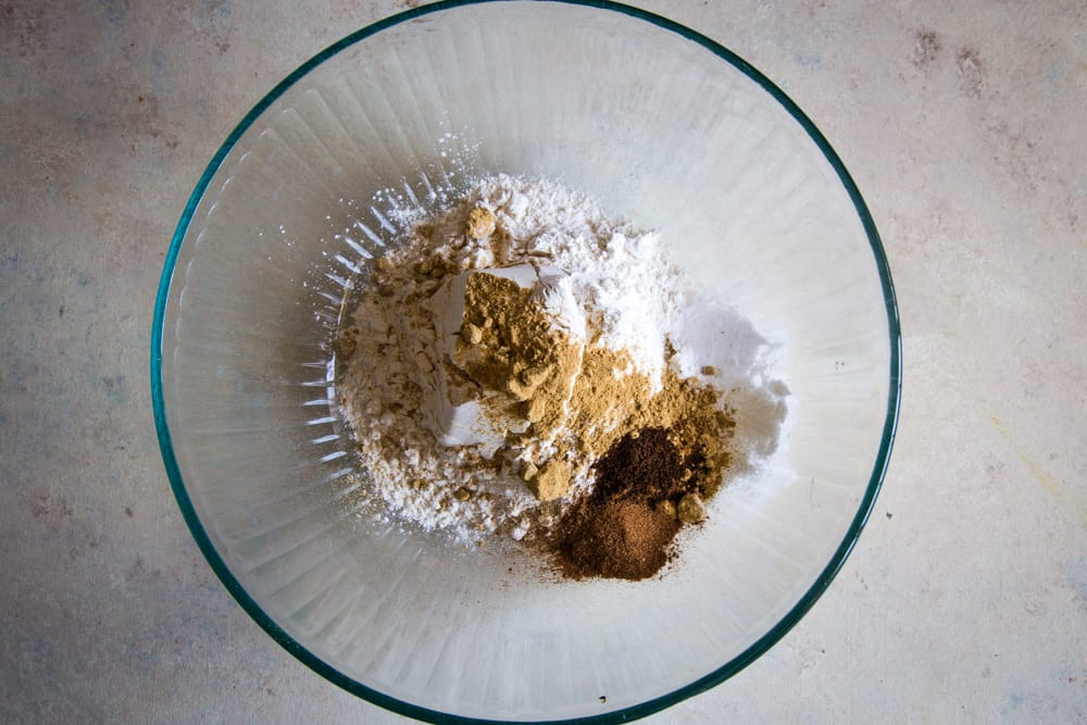dry spices in large bowl for gingerbread layer cake