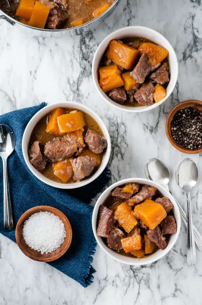 butternut squash beef stew with bowl of salt