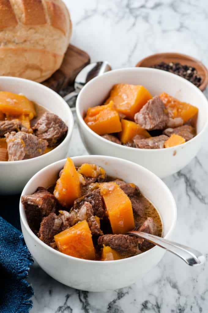 white bowls with butternut squash beef stew