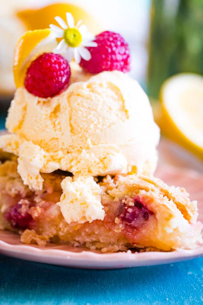 a slice of lemon raspberry pie with a scoop of ice cream