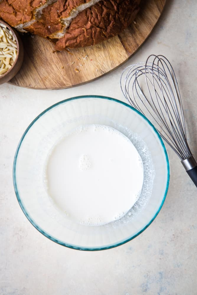 bowl of milk with whisk on the side